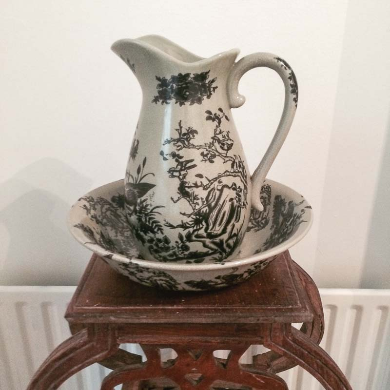 This gorgeous victorian pitcher and bowl keeps in the theme of the victorian house